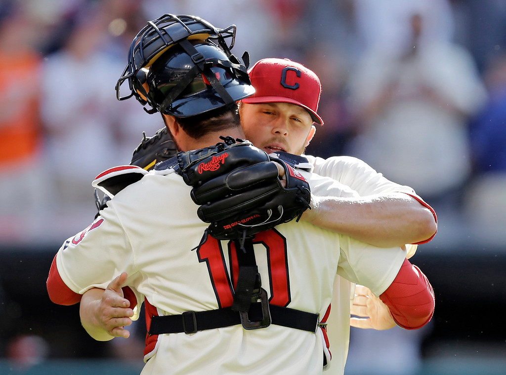 . Cleveland Indians relief pitcher Cody Allen hugs catcher Yan Gomes after saving a 7-6 win over the Colorado Rockies in a baseball game Saturday, May 31, 2014, in Cleveland. (AP Photo/Mark Duncan)