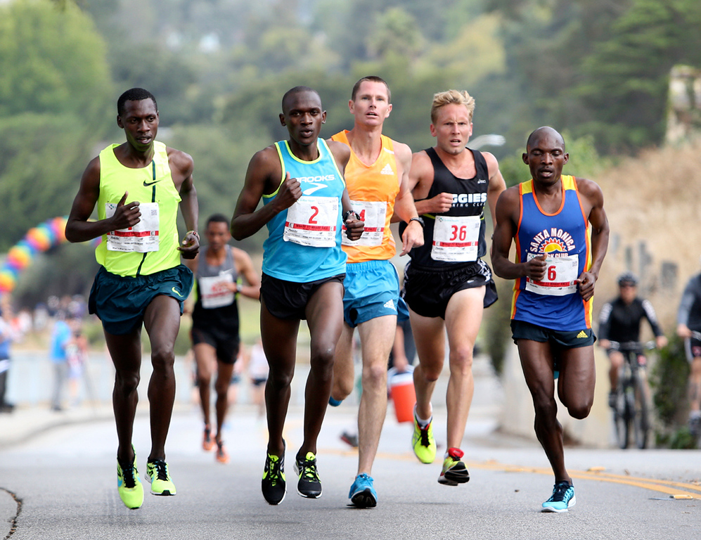 . The Wharf to Wharf elite runner breech the first major hill of the course in Santa Cruz on Sunday. (Kevin Johnson -- Santa Cruz Sentinel)