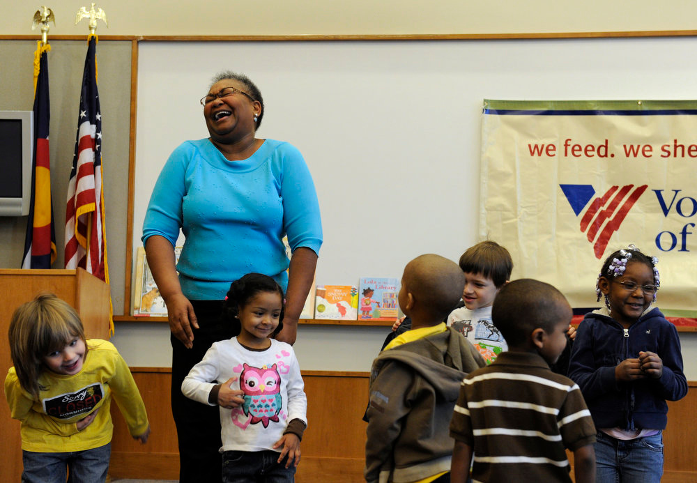 Description of . Denver singer Hazel Miller joins local pre-school and kindergarten children at the Blair Caldwell Library on Friday, Feb. 10, 2012 to help celebrate Black History Month by reading several books and singing a few songs. Clifford the Big Red Dog and Winnie the Pooh were also there to entertain the kids. All the kids are told to take a bow after singing a song. Kathryn Scott Osler, The Denver Post