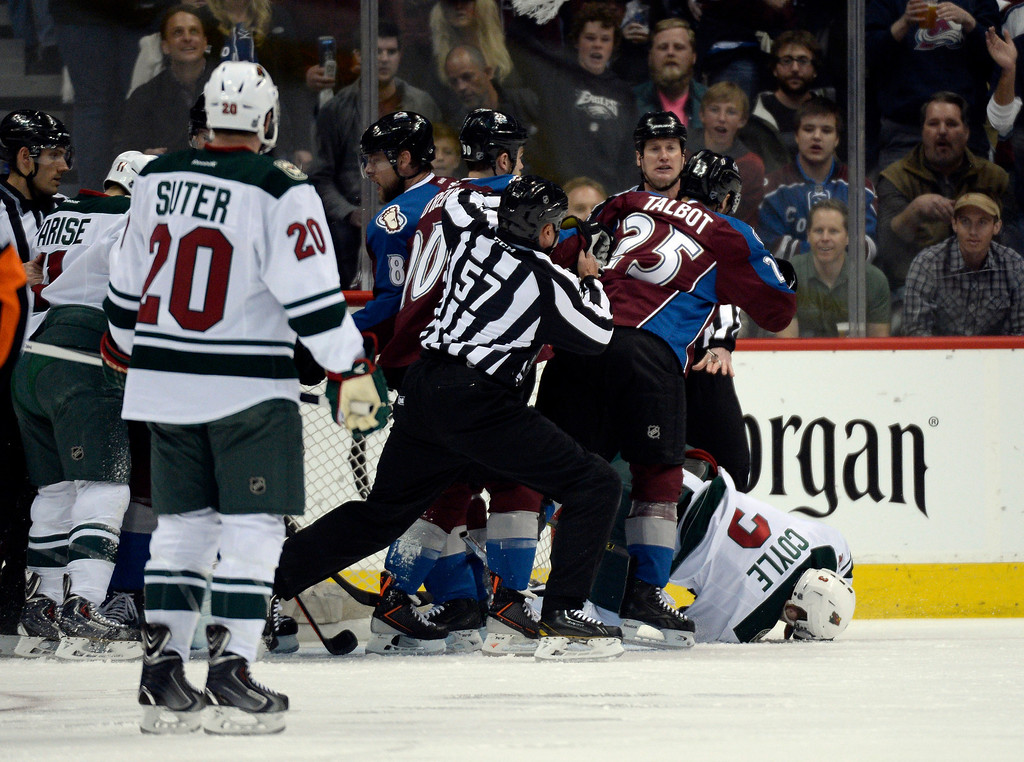 . Charlie Coyle (3) of the Minnesota Wild goes down during a skirmish in the first period of action. The Colorado Avalanche hosted the Minnesota Wild in the first round of the Stanley Cup Playoffs at the Pepsi Center in Denver, Colorado on Saturday, April 19, 2014. (Photo by John Leyba/The Denver Post)