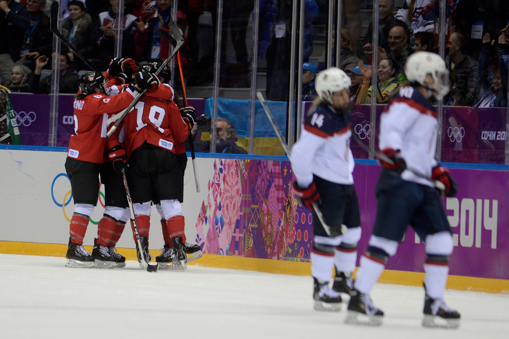 . Canada celebrates their first goal of the game against the U.S.A. during the third period of the women\'s gold medal ice hockey game. Sochi 2014 Winter Olympics on Thursday, February 20, 2014 at Bolshoy Ice Arena. (Photo by AAron Ontiveroz/ The Denver Post)