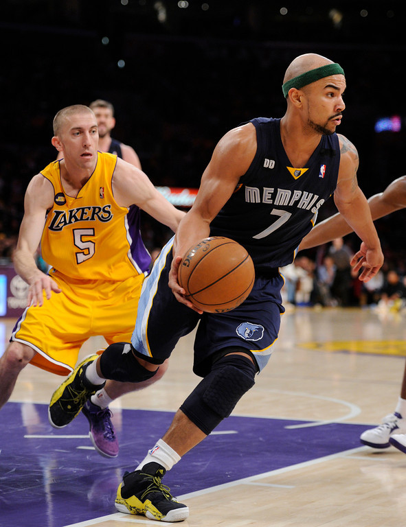 . The Lakers\' Steve Blake chases down the Grizzlies\' Jerryd Bayless, Friday, April 5, 2013, at Staples Center. (Michael Owen Baker/Staff Photographer)