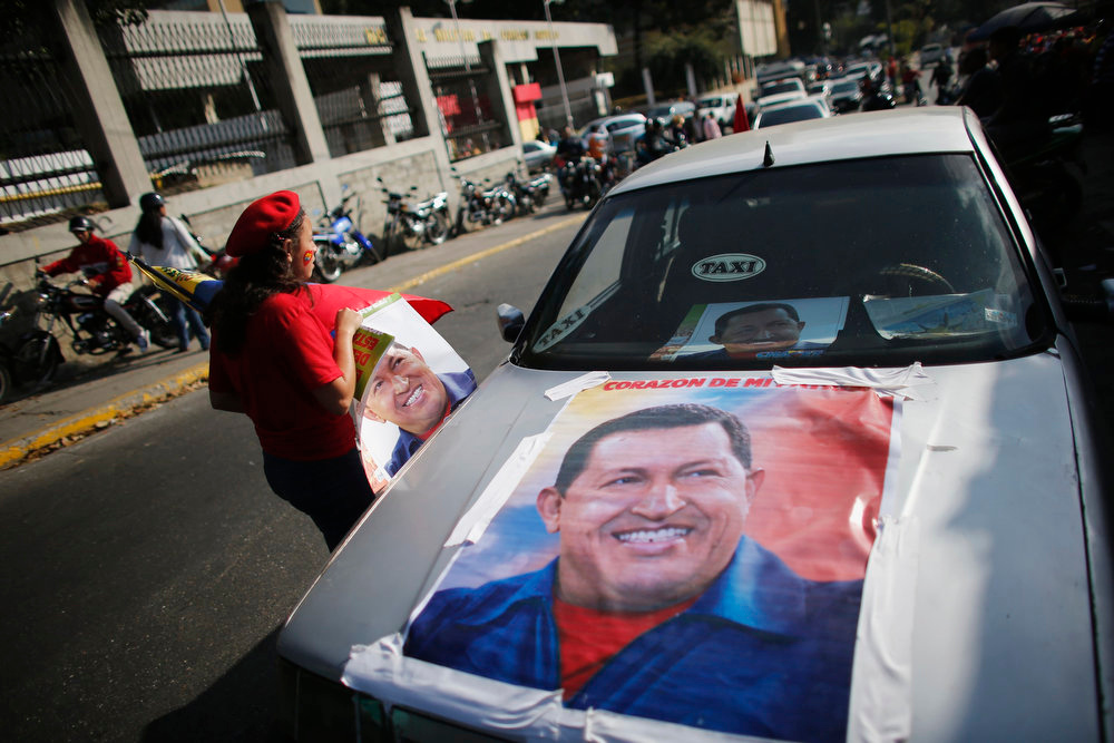 . A supporter of Venezuela\'s President Hugo Chavez walks outside the military hospital after his surprise return to Caracas February 18, 2013. Chavez made a surprise return from Cuba on Monday more than two months after surgery for cancer that has jeopardized his 14-year rule of the South American OPEC member. The 58-year-old socialist leader underwent a six-hour operation in Cuba on December 11. He had not been seen or heard in public since then until photos were published of him on Friday. REUTERS/Jorge Silva
