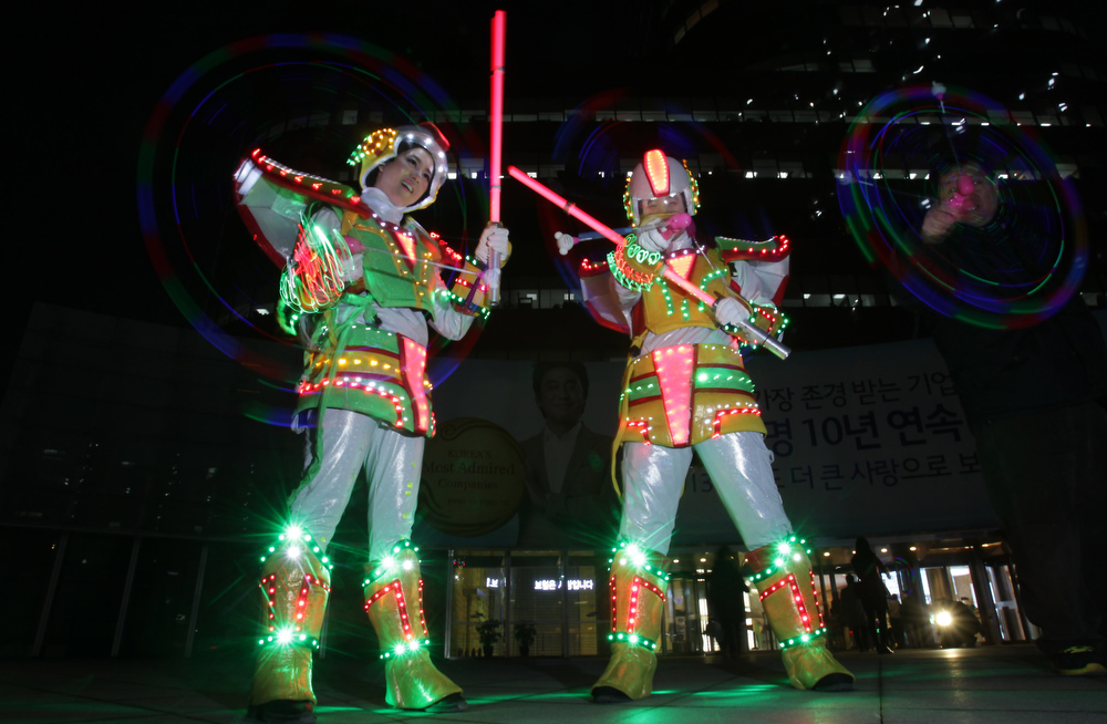 . Performers spin illuminated cans during \'Cyber Jwibulnoli\' at Everland on February 21, 2013 in Seoul, South Korea. Jwibulnoli is originally played on the first full moon of the lunar year, that is February 25 this year.  (Photo by Chung Sung-Jun/Getty Images)