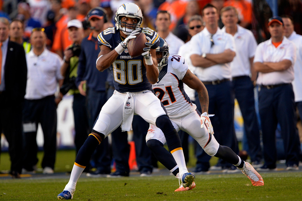 . SAN DIEGO, CA. December 14, - wide receiver Malcom Floyd #80 of the San Diego Chargers makes a catch in front of cornerback Aqib Talib #21 of the Denver Broncos at Qualcomm Stadium December 14, 2014 San Diego, CA (Photo By Joe Amon/The Denver Post)