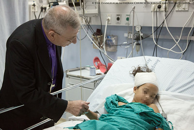 Bishop Younan Visits Wounded from 2014 Gaza War (Blur)