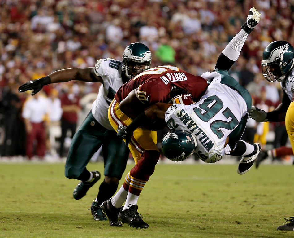 . Cornerback Cary Williams #26 of the Philadelphia Eagles sacks quarterback Robert Griffin III #10 of the Washington Redskins in the second quarter at FedExField on September 9, 2013 in Landover, Maryland.  (Photo by Rob Carr/Getty Images)
