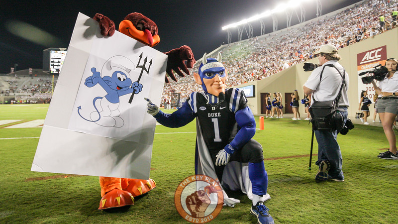 The Hokiebird holds up a homemade sign next to the Duke Blue Devil in the South Endzone. (Mark Umansky/TheKeyPlay.com)