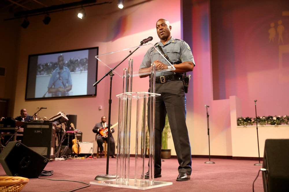 . Capt. Ronald Johnson (R) of the Missouri State Highway Patrol, who was appointed by the governor to take control of security operations in the city of Ferguson, speaks at an event at the Greater Grace Church by first apologizing to Michael Browns family on August 17, 2014 in Ferguson, Missouri. The event was lead by the Rev. Al Sharpton in support of justice for Michael Brown who was killed by police on August 9th.  (Photo by Joe Raedle/Getty Images)