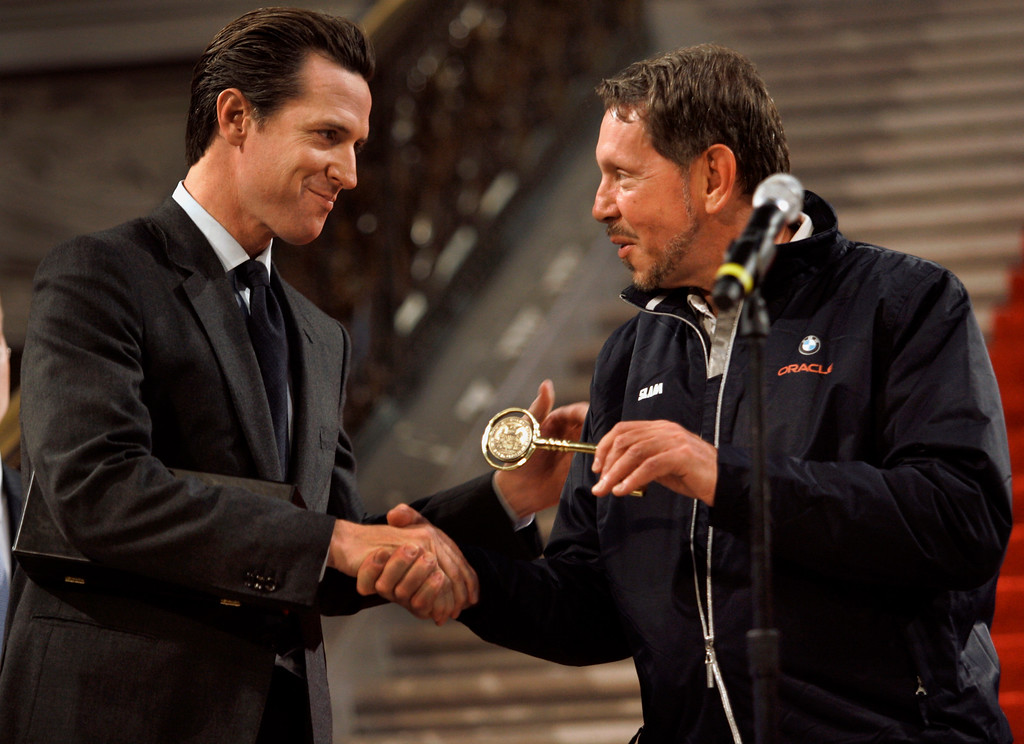 . Oracle\'s Larry Ellison, right, accepts a key to the city from San Francisco Mayor Gavin Newsom in the City Hall rotunda on Feb. 20, 2010, where Ellison and  BMW Oracle Racing\'s crew showed off their America\'s Cup trophy to a crowd of sailing enthusiasts. Ellison\'s home yacht club is the Golden Gate Yacht Club.  BMW Oracle Racing won the 33rd America\'s Cup off Valencia, Spain earlier this month. As part of the city\'s tribute to the team, Newsom gave the Oracle head a key to the city. (Pauline Lubens/Bay Area News Group Archives)