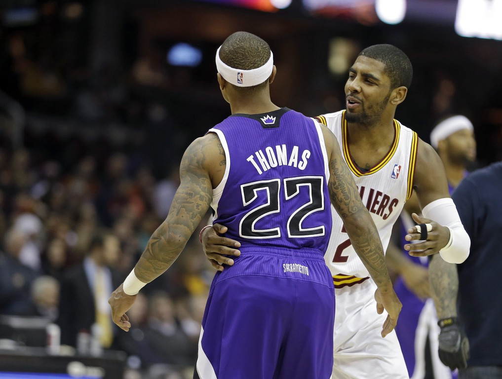 . Cleveland Cavaliers\' Kyrie Irving (2) greets Sacramento Kings\' Isaiah Thomas (22) before an NBA basketball game Tuesday, Feb. 11, 2014, in Cleveland. (AP Photo/Mark Duncan)