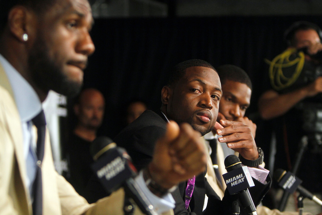 . LeBron James, left, Dwyane Wade, center, and Chris Bosh talk about the new Miami Heat team that they will be part of during a press conference after the Friday, July 19, 2010 fan fest in Miami. (AP Photo/J Pat Carter)