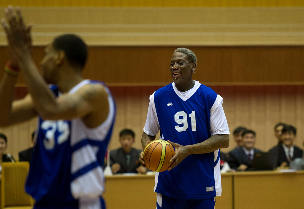 . Dennis Rodman, right, holds the ball near fellow U.S. player Jerry Dupree during an exhibition basketball game between U.S. and North Korean players at an indoor stadium in Pyongyang, North Korea on Wednesday, Jan. 8, 2014. (AP Photo/Kim Kwang Hyon)