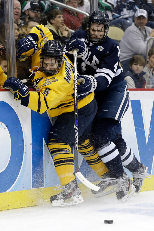 . Quinnipiac\'s Cory Hibbeler (6) collides with Yale\'s Rob O\'Gara (4) during the first period of the NCAA Frozen Four men\'s college hockey national championship game in Pittsburgh on Saturday, April 13, 2013. (AP Photo/Gene Puskar)