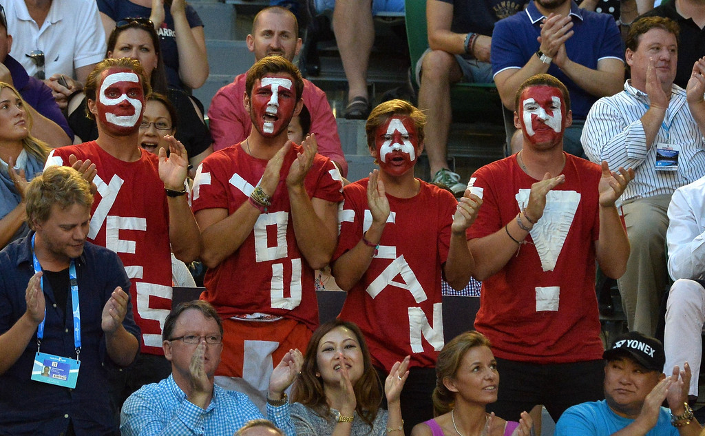 . Fans of Stanislas Wawrinka of Switzerland cheer him on as he plays against Rafael Nadal of Spain in the men\'s singles final on day 14 of the 2014 Australian Open tennis tournament in Melbourne on January 26, 2014.   PAUL CROCK/AFP/Getty Images