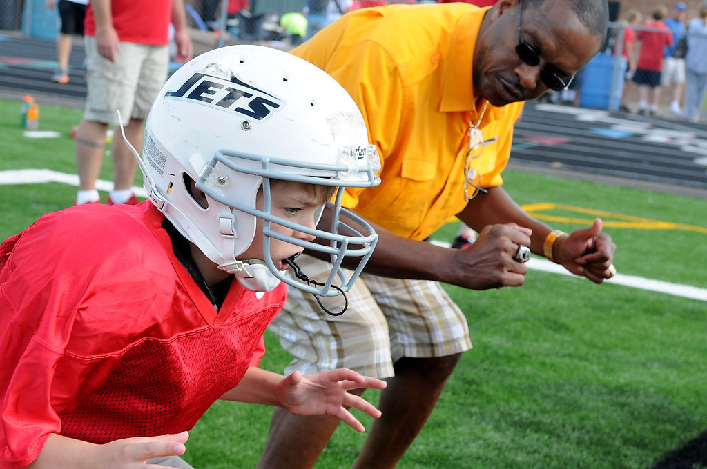 ". Luke Schneider gets some blocking tips from John Swain during Centennial�s first ""Cougar Combine\"" event July 28 in Circle Pines. (Pioneer Press: Sherri LaRose-Chiglo)"