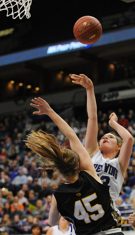 . Red Wing Wingers forward McKenzie Muelken (13) gets the points and the foul as she shoots over DeLaSalle Islanders guard Amanda Cline (45) in the first half. (Pioneer Press: John Autey)