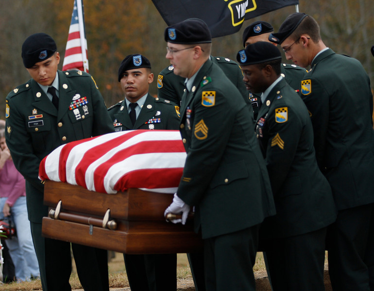 The Honor Guard carries Staff SGT Chris Newman's casket.