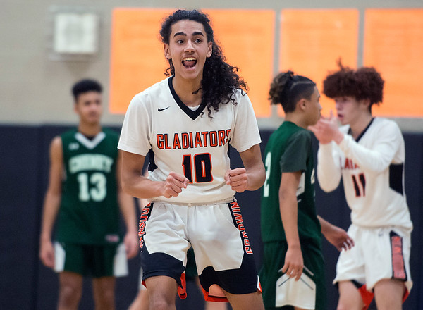 02/07/20 Wesley Bunnell | StaffrrGoodwin Tech boys basketball defeated Cheney Tech at home on Friday February 7, 2020. Damien Garcia (10) reacts to the play.
