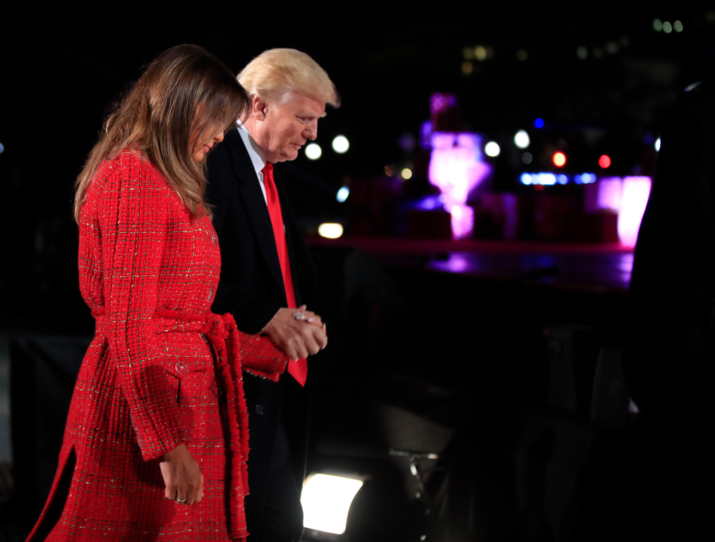 . President Donald Trump holds first lady Melania Trump\'s hand as they walk back to the stage during the lighting ceremony for the 2017 National Christmas Tree on the Ellipse near the White House in Washington, Thursday, Nov. 30, 2017. (AP Photo/Manuel Balce Ceneta)