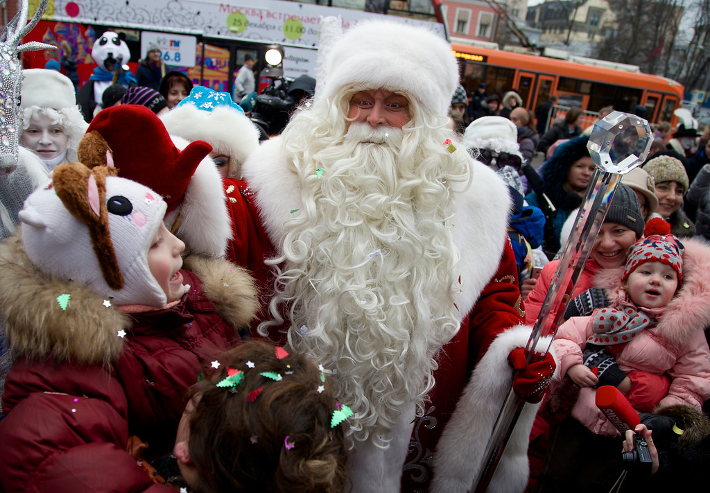 . Russian Ded Moroz (Father Frost)  arrives in Moscow Zoo, as a part of a New Year celebrations, in Moscow, Russia, on Wednesday, Dec. 25, 2013. Russians celebrate Orthodox Christmas on Jan. 7.(AP Photo/ Ivan Sekretarev)