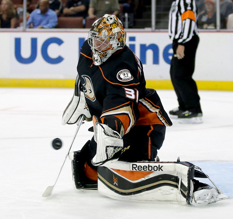 . Anaheim Ducks goalie Frederik Andersen blocks against the Colorado Avalanche during the first period of an NHL hockey preseason game in Anaheim, Calif., Monday, Sept. 22, 2014. (AP Photo/Chris Carlson)