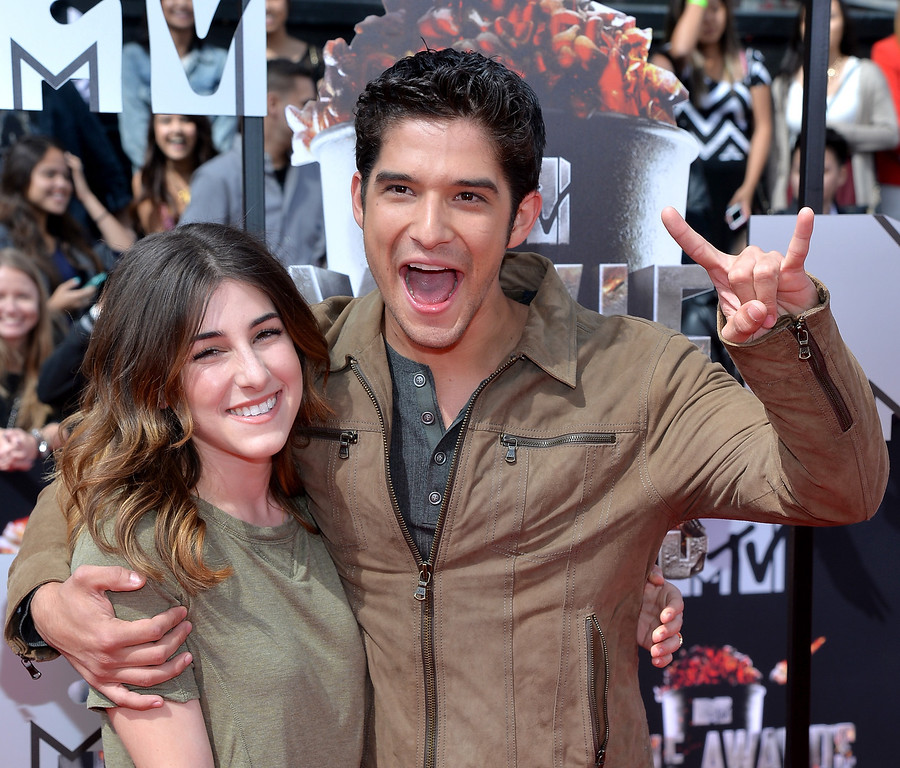 . Actor Tyler Posey (R) and Seana Gorlick attend the 2014 MTV Movie Awards at Nokia Theatre L.A. Live on April 13, 2014 in Los Angeles, California.  (Photo by Michael Buckner/Getty Images)