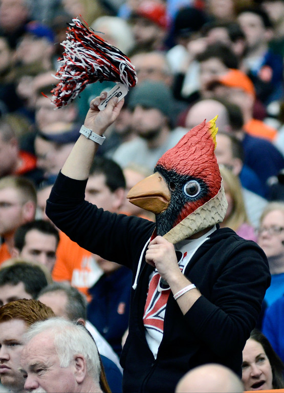 . A masked Louisville fan cheers during the first half of a regional final against Michigan State in the NCAA men\'s college basketball tournament Sunday, March 29, 2015, in Syracuse, N.Y. (AP Photo/Heather Ainsworth)