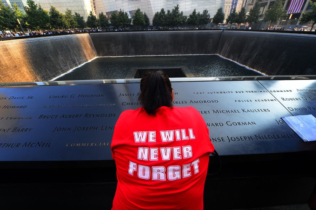 . Friends and family members gather at the 9/11 Memorial during ceremonies marking the 12th anniversary of the 9/11 attacks on the World Trade Center on September 11, 2013 in New York City. (Photo by Alejandra Villa-Pool/Getty Images)