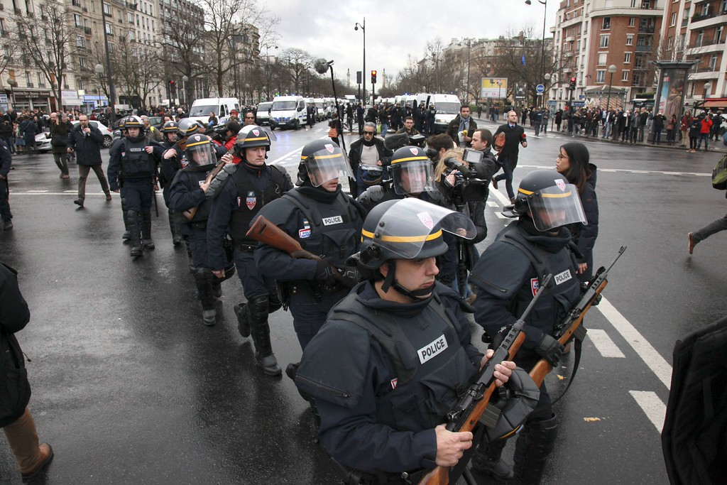 . French police officers arrive to take up positions near Porte de Vincennes in Paris on January 9, 2015, after at least one person was injured when a gunman opened fire at a kosher grocery store and took at least five people hostage, sources told AFP. The attacker was suspected of being the same gunman who killed a policewoman in a shooting in Montrouge in southern Paris on January 8. AFP PHOTO / LOIC VENANCE/AFP/Getty Images