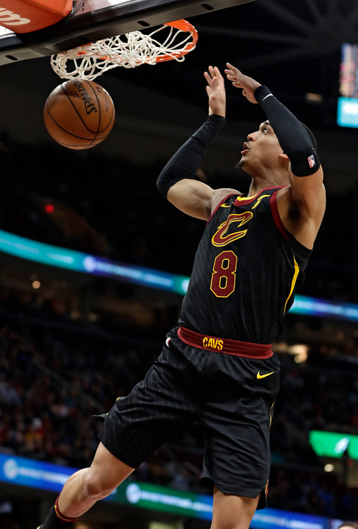 . Cleveland Cavaliers\' Jordan Clarkson dunks against the Washington Wizards in the first half of an NBA basketball game, Thursday, April 5, 2018, in Cleveland. (AP Photo/Tony Dejak)