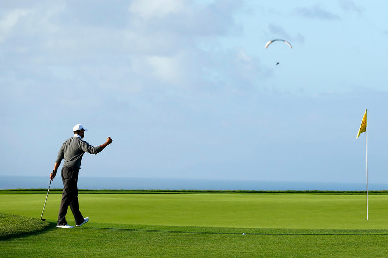 . U.S. golfer Tiger Woods celebrates chipping in for a birdie on the fourth hole during weather delayed fourth round play at the Farmers Insurance Open in San Diego, California January 27, 2013. REUTERS/Mike Blake
