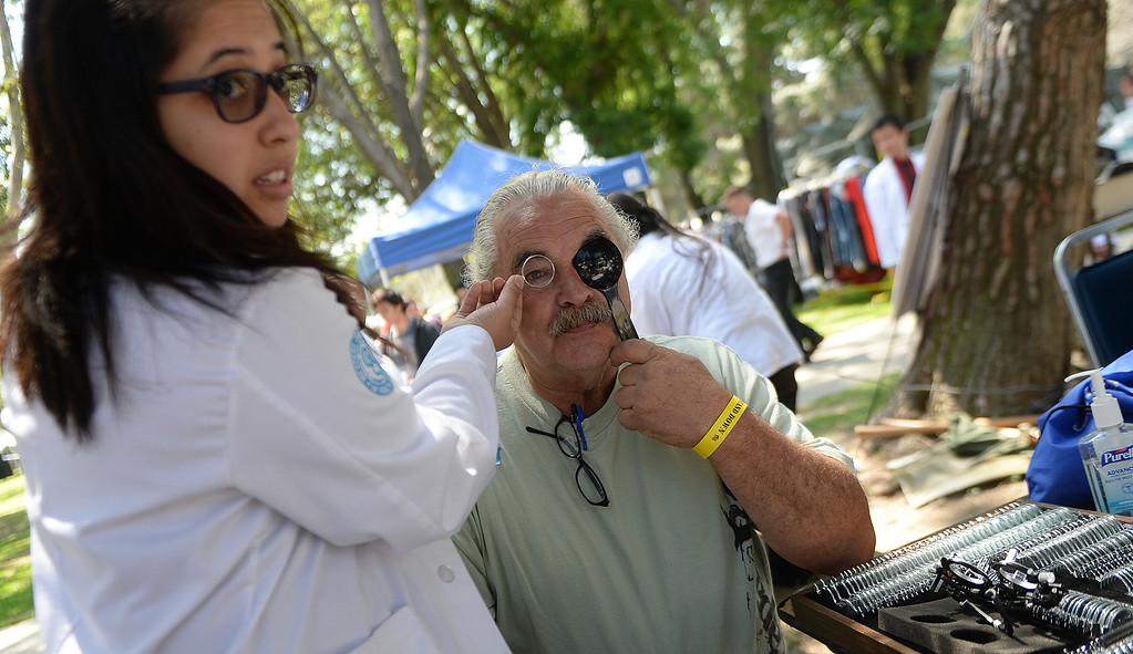 . Katie Allen, left, gives an eye exam to US Army veteran, Jerry Bostock during �Heroes in the Shadows� San Gabriel Valley Homeless Stand Down, A three day event presented by The Vet Hunters Project and The SGV Veterans Employment Committee aims to combat Homelessness by providing on site assistance, services and resources to those in need at Whittier Narrows Recreation Park in South El Monte, Calif., on Saturday, April 5, 2014.  (Keith Birmingham Pasadena Star-News)