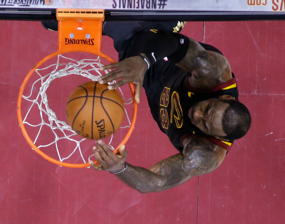. Cleveland Cavaliers\' LeBron James dunks during the first half of Game 4 of basketball\'s NBA Finals against the Golden State Warriors, Friday, June 8, 2018, in Cleveland. (AP Photo/Carlos Osorio, Pool)