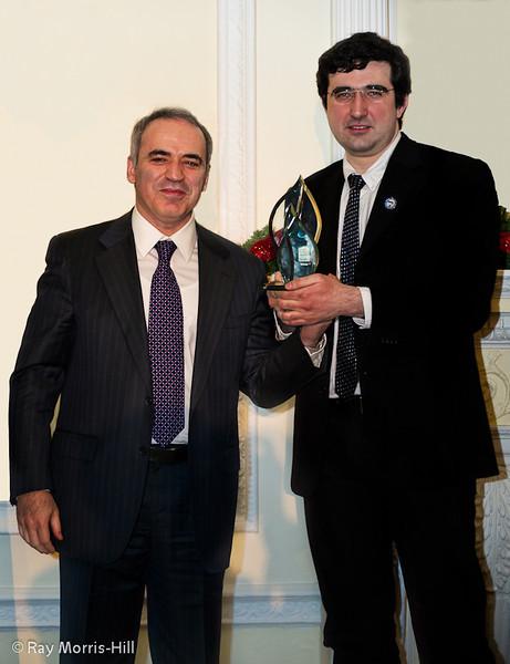 Garry Kasparov presents the trophy and winners cheque for €50,000 to London Classic winner 2011, Vladimir Kramnik