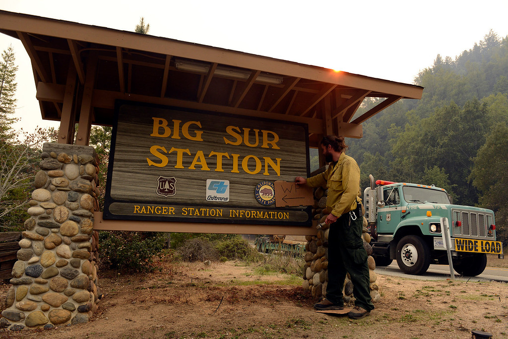 . U.S. Fire Service firefighter Andrew Way puts a sign up at the Big Sur Station indicating the area as a water point for other firefighters as they battle a wildland fire in the Pfeiffer Ridge area in Big Sur on Monday December 16, 2013. (Photo David Royal/ Monterey County Herald)