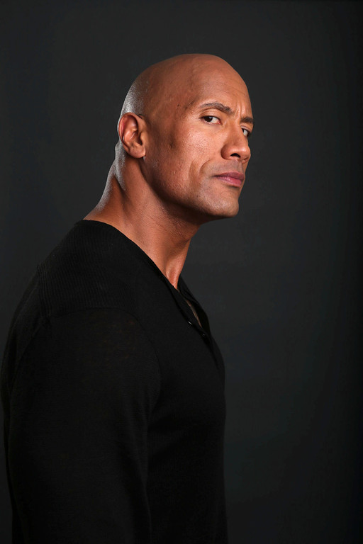 . In this Saturday, March 23, 2013 photo, Dwayne Johnson poses for a portrait at the Four Seasons in Los Angeles. The 40-year-old actor has become a savior of stale film series, injecting new life into �Fast Five,� �The Mummy Returns,� �Journey 2: The Mysterious Island� and now �G.I. Joe: Retaliation.� The former professional wrestler rocks bourgeoning and established franchises by joining them on the second or subsequent installment and boosting the property\'s box office. (Photo by Eric Charbonneau/Invision/AP)