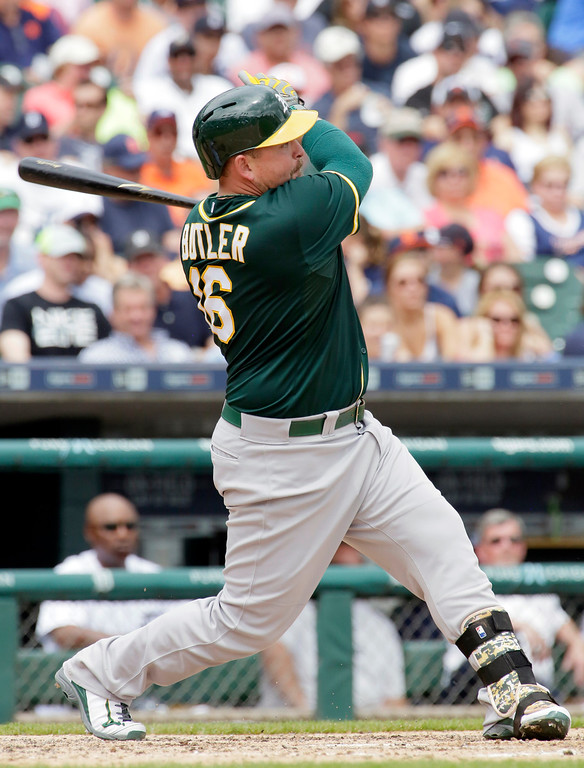. Oakland Athletics\' Billy Butler singles to left field to drive in Billy Burns during the fifth inning of a baseball game against the Detroit Tigers at Comerica Park, Thursday, June 4, 2015, in Detroit. Tigers left fielder Daniel Fields fielding error also allowed Oakland\'s Stephen Vogt to score. (AP Photo/Duane Burleson)