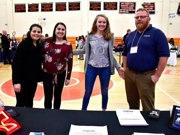 5/3/2019 Mike Orazzi | Staff Laurentano Sign Company's Amber Mohagel, Stephanie Aquino, Tabitha Kennedy and Robert Kennedy during the 9th Annual Terryville High School Career Fair on Friday morning.