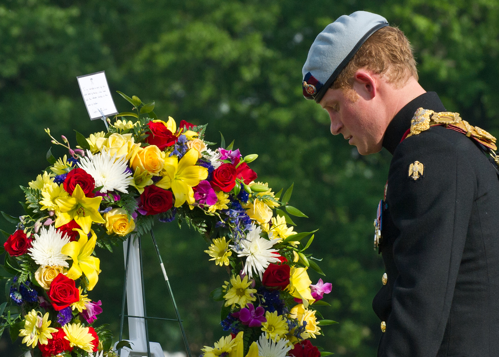 . England\'s Prince Harry lays a wreath at Section 60 of Arlington National Cemetery, where veterans of the wars in Iraq and Afghanistan are buried, in Virginia on May 10, 2013.    (AP PHOTO/Nicholas Kamm, Pool)