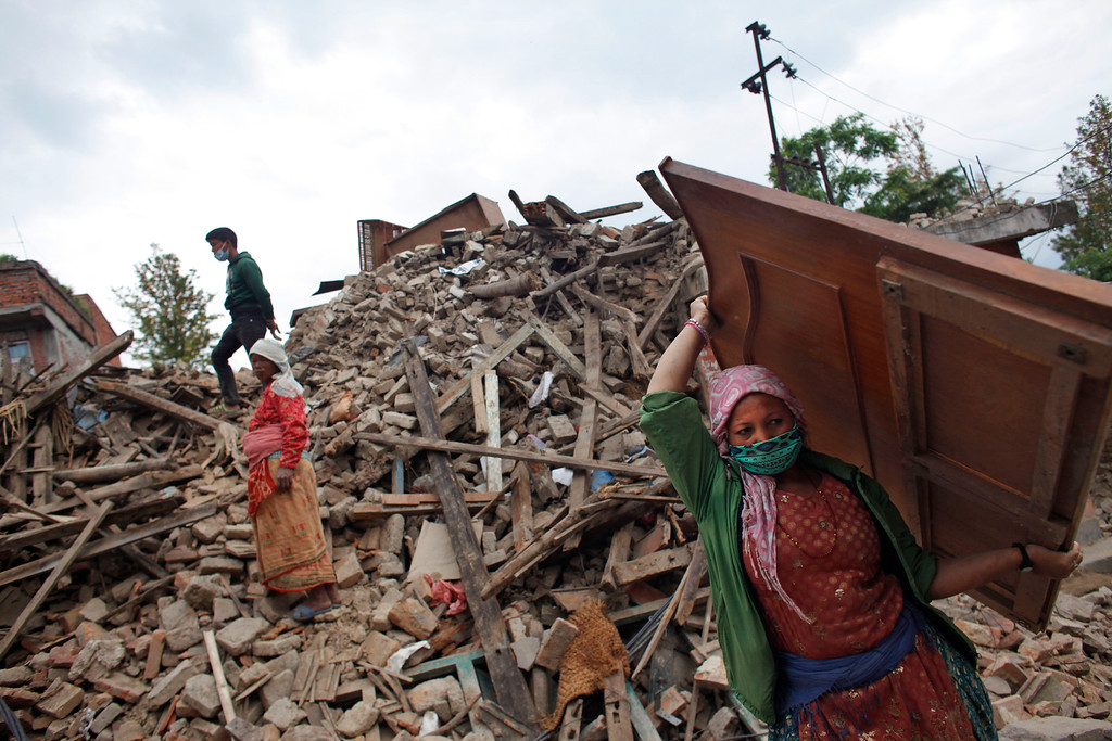 . Nepalese earthquake-affected victims salvage belongings from their damaged homes in Lalitpur, on the outskirts of Kathmandu, Nepal, Thursday, April 30, 2015. In mere seconds, Saturday\'s earthquake devastated a swathe of Nepal. Three of the seven World Heritage sites in the Kathmandu Valley have been severely damaged, including Durbar Square with pagodas and temples dating from the 15th to 18th centuries, according to UNESCO, the United Nations cultural agency. (AP Photo/Niranjan Shrestha)