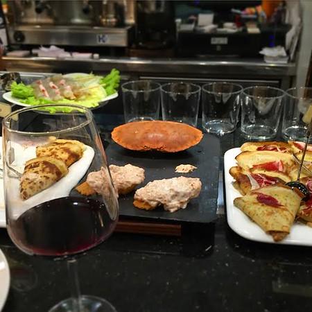Pintxos and wine in a San Sebastian bar.