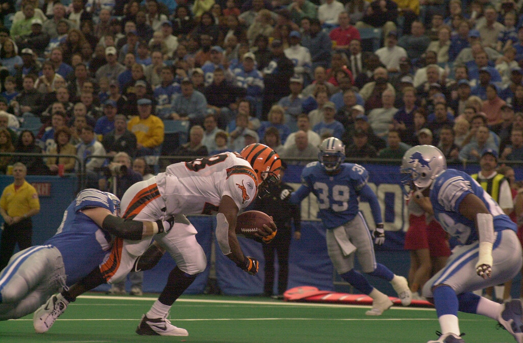 . Corey Dillon (28) of the Cincinnati Bengals is hit by Clint Kriewaldt (58) of the Detroit Lions in the first half during Sunday\'s game played at the Pontiac Silverdome. The Lions lost 31-27 to the Bengals.