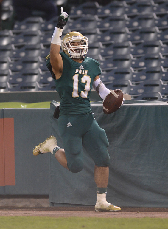 . Anaheim, Calif., --12-01-12 - Long Beach Poly\'s Manusamoa Luuga,13, celebrates after scoring a touchdown in the 1st quarter  of the CIF-SS Pac-5 Division final game against Mater Dei , at Anaheim Stadium.   Stephen Carr/  LANG