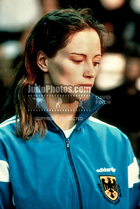 1989 Belgrade Worlds 891014A18: Gabriele Ritschel of Germany patiently waits to receive 61kgs bronze  medal.....