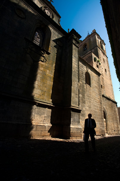 Man walking in front of San Mateo church, Caceres, Spain