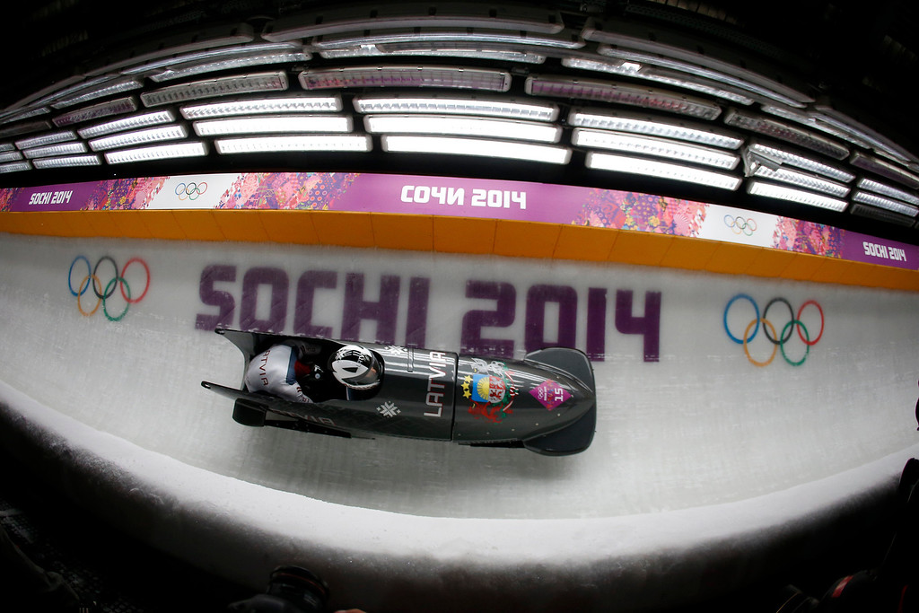 . A Latvian team heads down turn five for the Two-man Bobsleigh at the Sanki Sliding Center for the 2014 Winter Olympics in Krasnaya Polyana, Russia, on Sunday, Feb. 16, 2014.  (Nhat V. Meyer/Bay Area News Group)