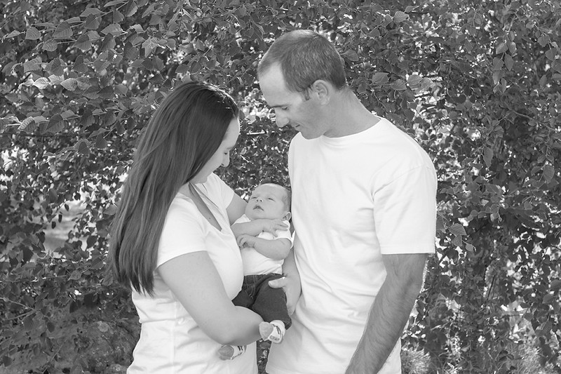 black and white mom and dad with baby.jpg