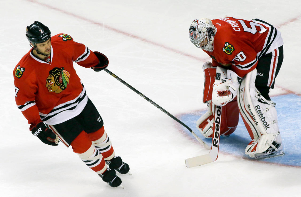 . Chicago Blackhawks\' Brent Seabrook (7), left, tries to cheer up to goalie Corey Crawford (50) after Minnesota Wild\'s Justin Fontaine (14) scored during the third period. (AP Photo/Nam Y. Huh)