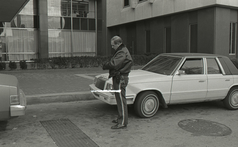 Police Officer Writing Ticket, October 27, 1988, Img. 1